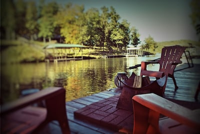 Relax in an adirondack style chair next to the firepit on the 40 ft swim deck.