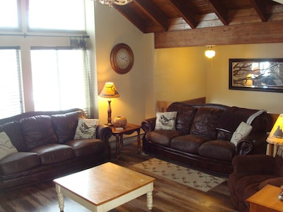 The living room has comfortable seating for relaxing and enjoying time together.