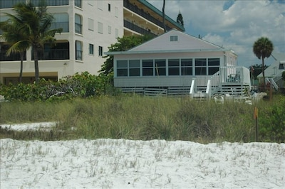 The Griffin Cottage viewed from the edge of the Gulf of Mexico.