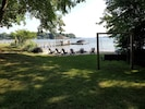 The sandy beach area has Adirondack chairs to enjoy the view.