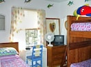 Bunk bed room sleeps 4 children. Great hideaway for a rainy day!