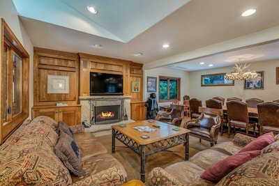 Living Room/Dining Room with wood burning fireplace and Large Screen TV