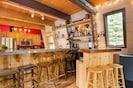 Bar area with seating for 8+, beer fridge, shot ski & plenty of bar utensils