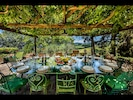Main Villa: Outdoor Dining area with large table seating up to 18 guests
