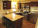 Progressive yet traditional fully appointed kitchen w state of art appliances.