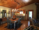indoor dining, table and kitchen beyond