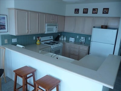 Kitchen with Gas Range, Refrigerator w/ Ice Maker,  Microwave and Dishwasher
