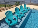 The tanning ledge provides a great spot to lounge in this beautiful pool!