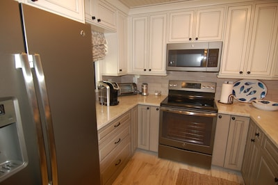 Our kitchen has everything you need including a Keurig coffee maker.