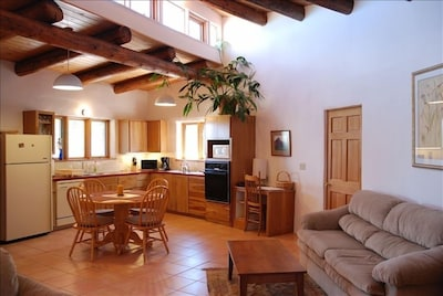 Fully equipped kitchen and dining area, opens into living room, big bright space