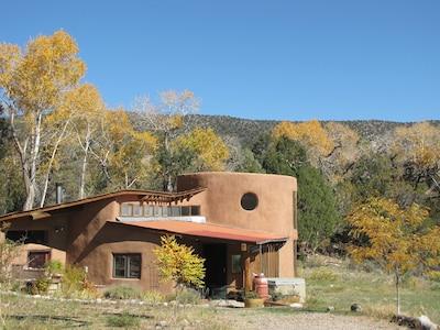 Custom Designed Passive Solar Adobe Home, curved walls, high ceilings, big views