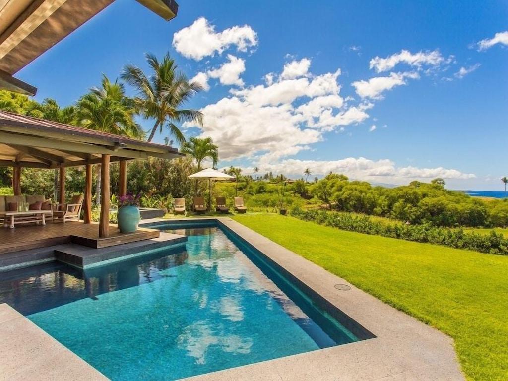 Lanai with geometrical pool and green lawn