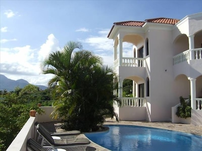 Porches overlooking the pool and Playa Cofresi