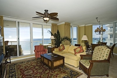 Large Living Room with great views of the Gulf & open to dinning room & kitchen.