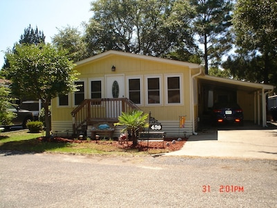 Front of Beach house showing sunroom and carport