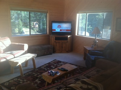 Main living area with satellite TV