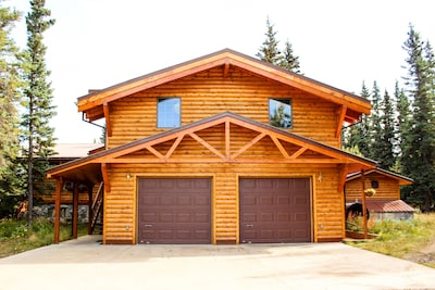Our home.  The two windows above the garage are the rental bedrooms.