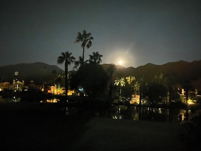Moon setting over the mountains, while sitting on our patio