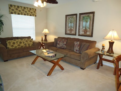 Townhome 1-Living room with new queen sleeper sofa & love seat.