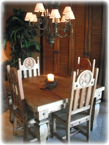 Dining Area with leather and wood amenities.