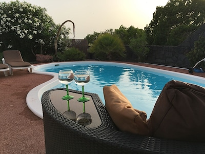 Pool view from outdoor sofa