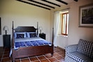 Double bedroom with additional sleeper couch and access to the gardens