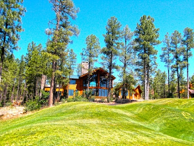 Back of our luxury Cabin standing on the first hole of the Golf Course