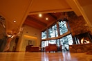 View of great room with fire and accordion doors open.