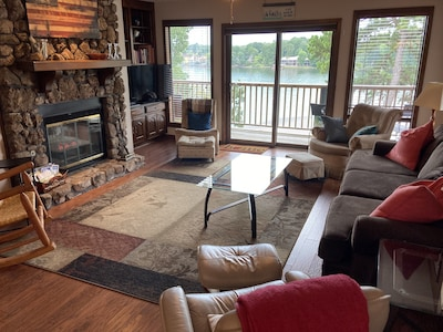Living room with outstanding lakefront views. Plenty of family seating, hdtv.