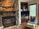 Electric fireplace for ambiance, wet bar, hdtv