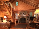 Living room, fireplace & log staircase