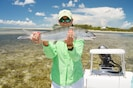 Wade and bonefish, get a guide or take the boat. Houses in background!