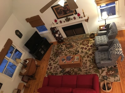 View of living room looking down from loft
