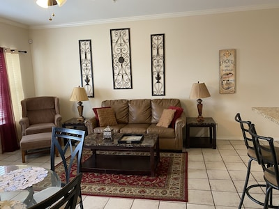 Kick back and relax in our open living room with sleeper sofa and flat screen TV