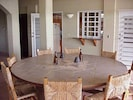 Huge round dinner table w/ totally open view of backyard gardens and beach!