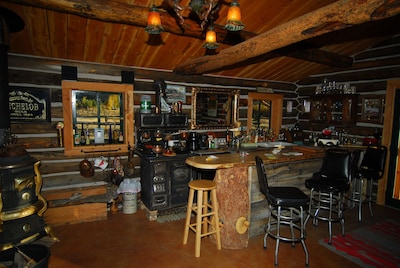 Bar and living area, indoor cooking and dining area.