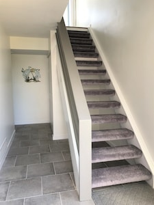 Entrance - 1st floor has 2 bedroom suites and laundry