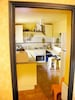 Our sunny kitchen - with a window opening out to the courtyard