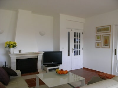 Comfortable seating, open fire and large TV