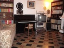 Living room with upright Petrof piano yearly tuned at 440Hz.