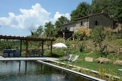 Casa dell'Ortolano (the Garden House) and its new bio-pool (added in 2019)