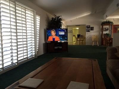 pool view living room, big screen tv