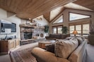 Family room with wood burning fireplace, HDTV, Apple TV, private balcony.