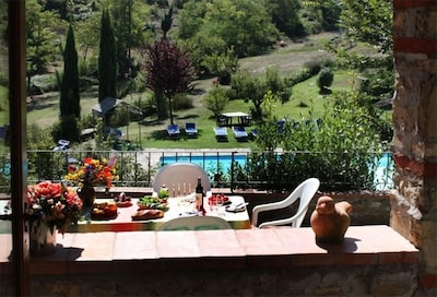 """swimming pool and playground  - seen from terrace of """"La Tana"""""""