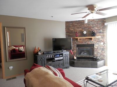 Living room with 40 inch flat screen TV and gas log fireplace