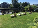 Relax in the Adirondack chairs and watch the boats and the ducks go by