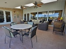 Spacious covered patio with access to den, living room and master bedroom.