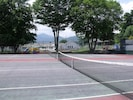 tennis courts and playground at the lake