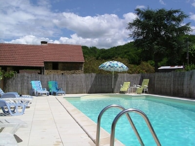 Private pool with covered games area beyond