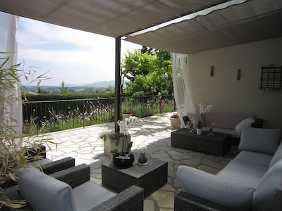 Shaded lounge overlooking pool and views to sea